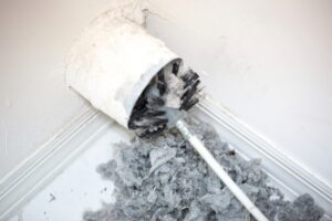 dirty-duct-with-brush-sticking-out-of-it